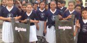 niños estudiando la separacion de basura